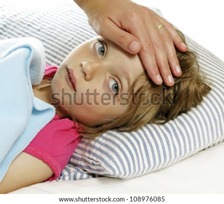mother takes care of the sick little girl with fever - stock photo