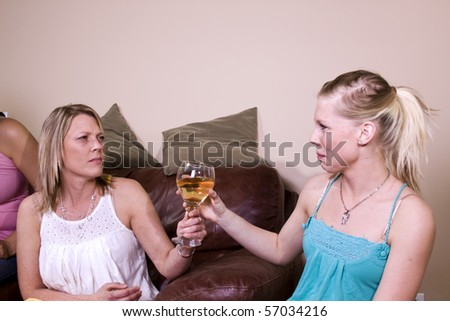 Mother Taking a Drink Away from Her Teenage Daughter