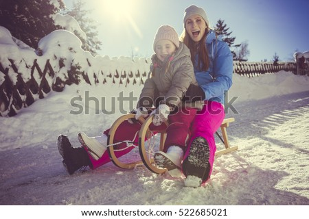 mother taking a ride outdoors