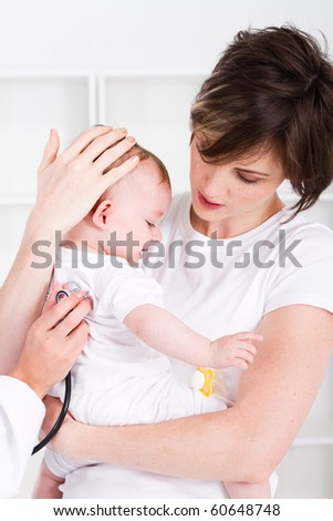 mother taking baby to doctor - stock photo