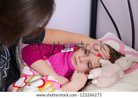Mother taking care about sick daughter - stock photo