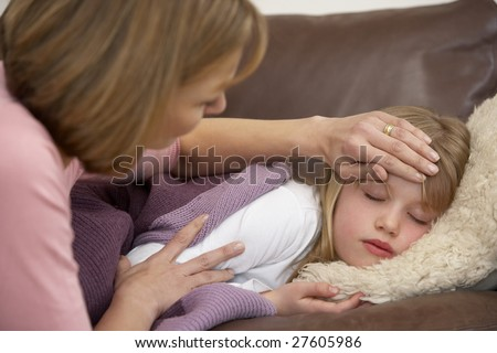 Mother Taking Temperature Of Sick Daughter - stock photo