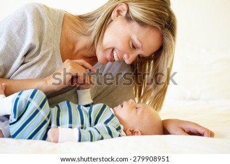 Mother talking to baby - stock photo