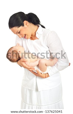 Mother talking with her newborn baby isolated on white background
