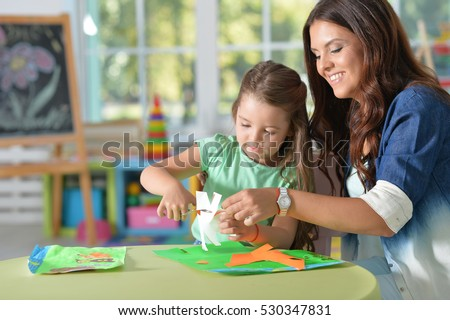 Mother teaches kid to do craft items
