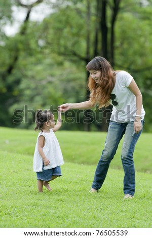 Mother teaching daughter learned a little walk in the park.