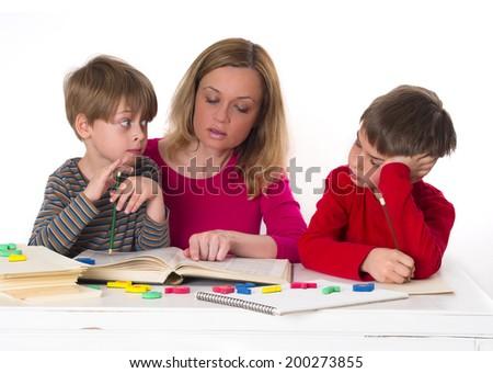 mother teaching her children - stock photo