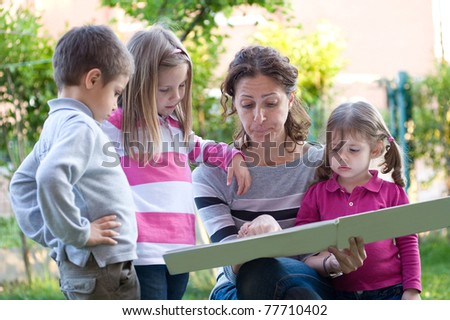 Mother telling a story to his sons. - stock photo