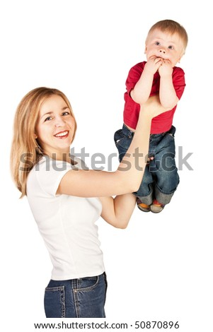 Mother tossing up surprised child on white background