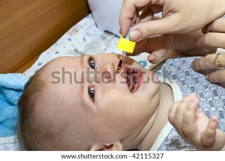 mother treats baby - stock photo