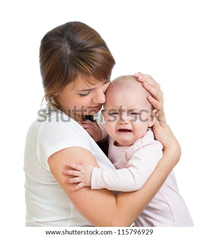 Mother trying to calm her crying baby isolated on white background - stock photo