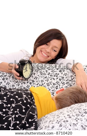 mother trying to wake up 4 years old boy - stock photo