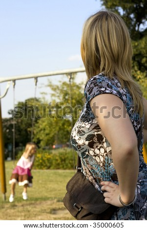 Mother watching her daughter playing outside