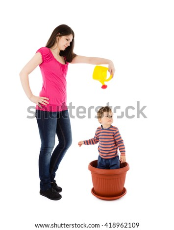 mother watering baby plant - stock photo