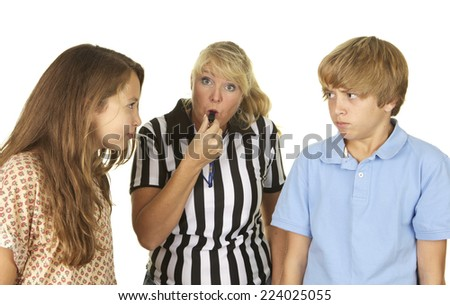 Mother wearing a referee shirt and blowing a whistle between her two arguing children.  shot in the studio on a white background. - stock photo
