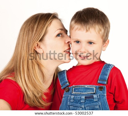 Mother whisper in son's ear - stock photo