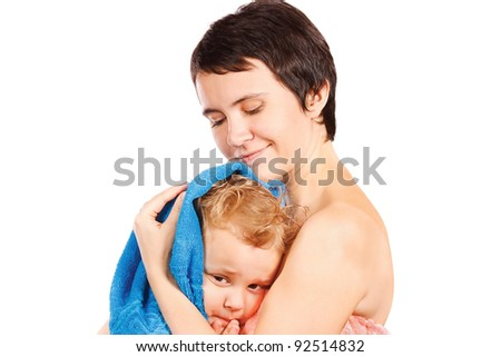 Mother wipes head to his son after bathing - stock photo