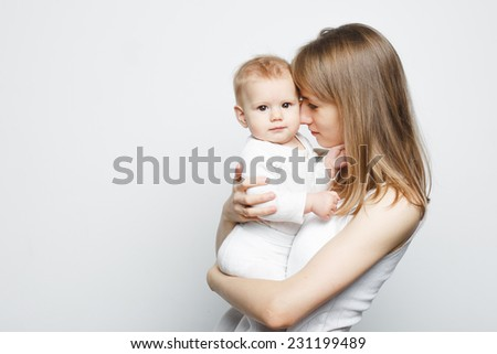 Mother with a baby in white over white background - stock photo