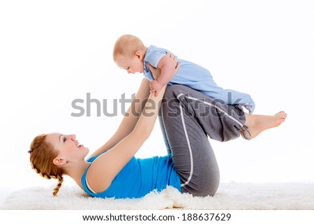 mother with a child engaged in yoga. doing exercises, physical exercises after childbirth. isolated on white background - stock photo