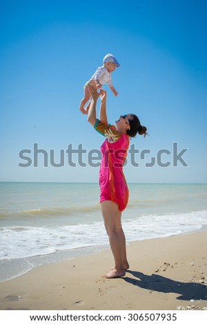 Mother with a child on the beach