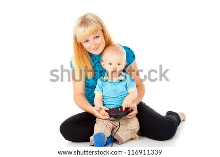 mother with a child playing on the video game joystick - stock photo