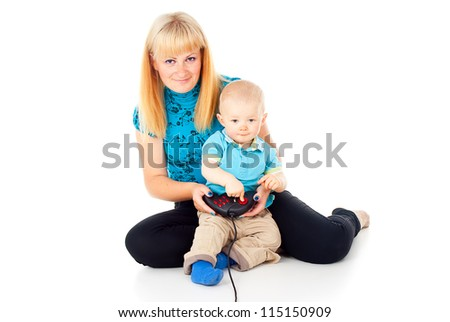 mother with a child playing video games with a joystick - stock photo