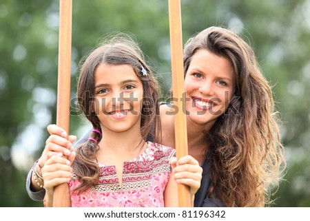 Mother with a daughter on stilts - stock photo