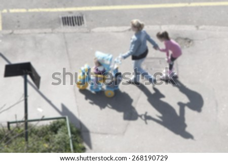 Mother with baby and daughter at outdoor - stock photo