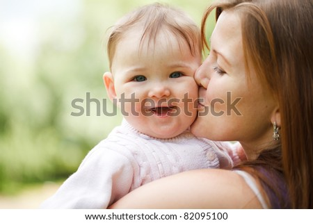 Mother with baby at outdoors - stock photo