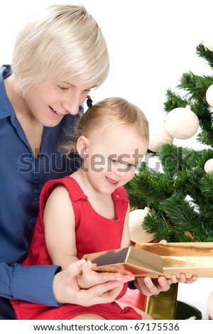 Mother with baby girl under christmas tree
