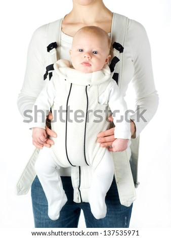 Mother with baby in baby carrier isolated on white - stock photo