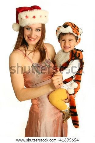 Mother with baby in fancy dress in the form of tiger on white background