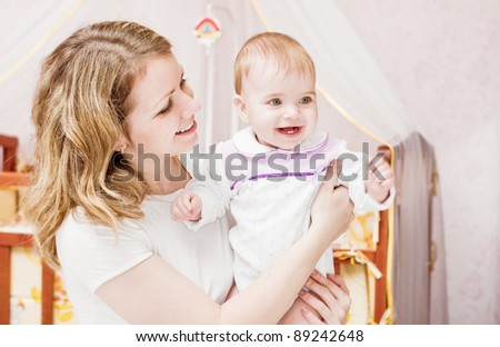 Mother with baby indoor - stock photo