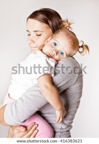 Mother with baby on hands - stock photo