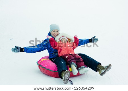 Mother with baby on the sled. - stock photo
