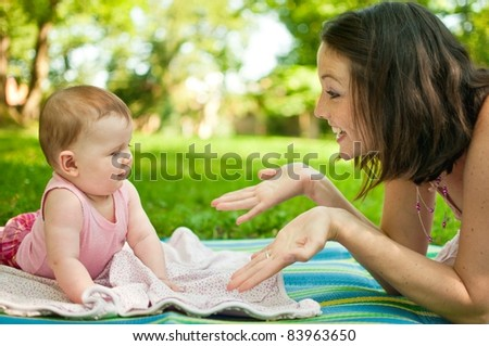 Mother with baby outdoor - stock photo