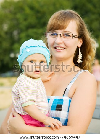 mother with baby playing in the park - stock photo