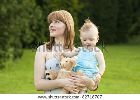Mother with baby playing in the park