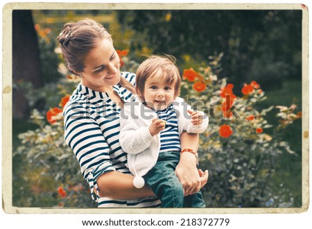 mother with child in the park - stock photo