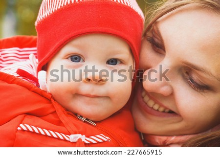 mother with child infant in the park in autumn  - stock photo