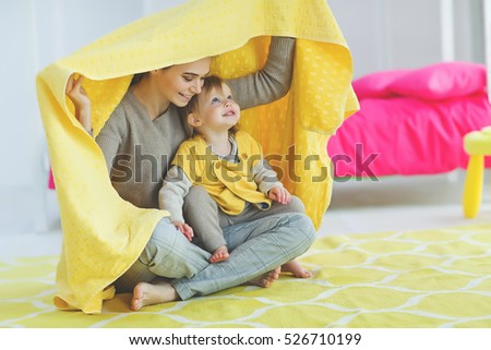 Mother with child playing at home