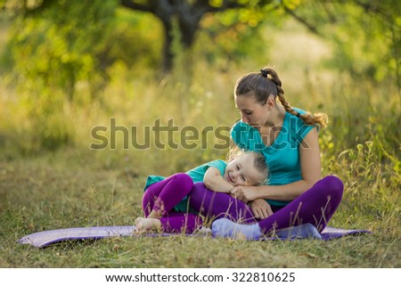 Mother with child sit in the park