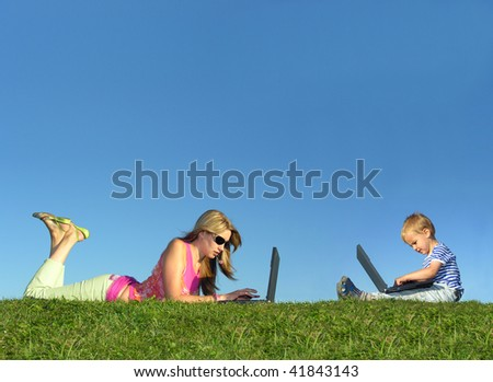mother with child with notebooks on grass collage - stock photo