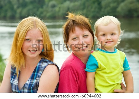 mother with children against river  in summ
