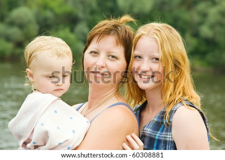 mother with children against river  in summer - stock photo