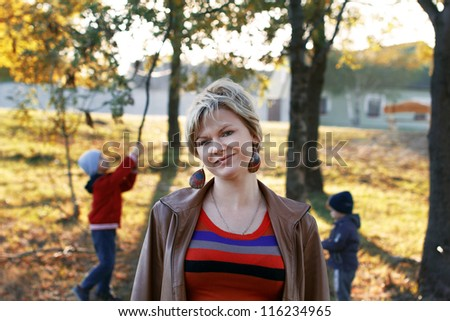 Mother with children at countryside - stock photo