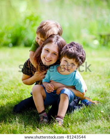 mother with children having a fun in summer park - stock photo