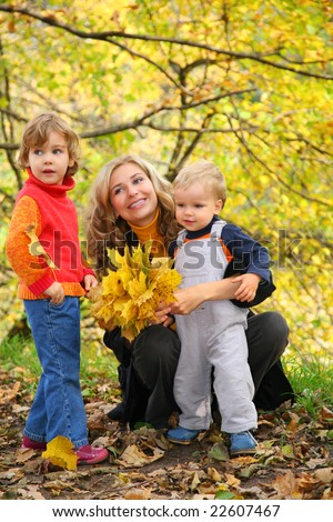 mother with children in autumn park