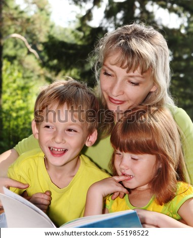Mother with children in nature - stock photo