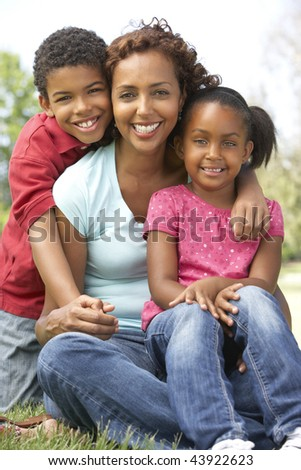 Mother With Children In Park - stock photo